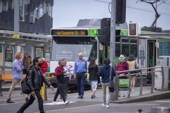 Commuters outside Melbourne's Flinders Street Station on Monday.
