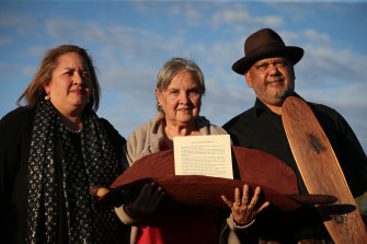 Megan Davis, Pat Anderson and Noel Pearson with a piti holding the Uluru Statement from the Heart in May 2017.