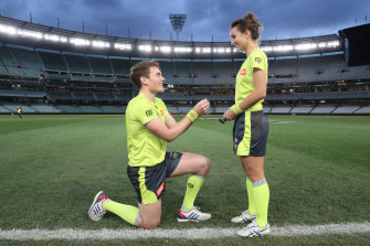 AFL umpire Dillon Lee asks ALF first field umpire Eleni Glouftsis to marry him after the Blues and Crows game at the MCG.