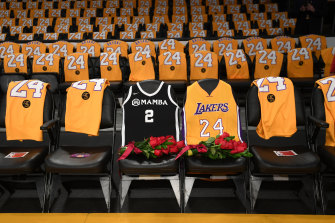 The Lakers honour Kobe Bryant and his daughter Gigi by covering the courtside seats they occupied with flowers, Gigi's Mamba jersey and Kobe's jersey before the game against the Portland Trail Blazers at Staples Center in Los Angeles.