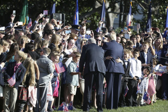 The two leaders greet visitors at the White House during the ceremonial welcome.