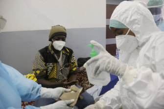 A COVID-19 patient is treated in N'Djamena, Chad. While the world's wealthier nations have stockpiled coronavirus vaccines for their citizens, many poorer countries are scrambling to secure enough doses.