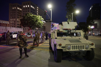 National Guardsmen stand watch as protests over the death of George Floyd continued in Los Angeles.
