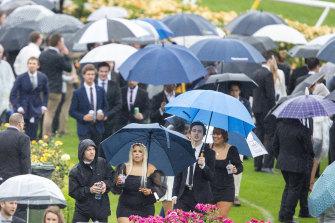 Rain didn't keep them away on Derby day.