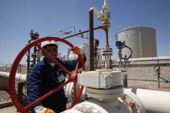 An oil field worker in Iraq.