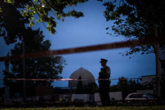 A policeman stands guard at the Al Noor Mosque in Christchurch.