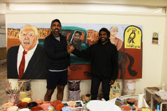 Adam Goodes in Vincent Namatjira's  Indulkana studio during a tour for the Indigenous Literacy and Numeracy Foundation.