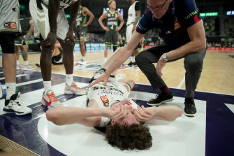 Josh Giddey of the 36ers reacts after hurting himself against the South East Melbourne Phoenix.