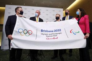 Brisbane Lord Mayor Adrian Schrinner, Federal Sports Minister Richard Colbeck, AOC president John Coates, Olympian James Tomkins and Queensland Premier Annastacia Palaszczuk celebrate in Tokyo.
