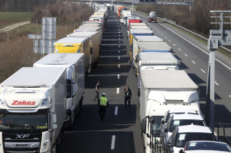 Trucks come to a standstill on a highway close to the border between Austria and Hungary.