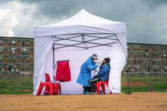 A resident from the Alexandra township gets tested for COVID-19 in Johannesburg, South Africa.
