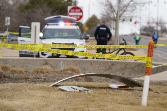 A piece of commercial airplane debris is surrounded by police tape where it landed in Broomfield, Colorado.