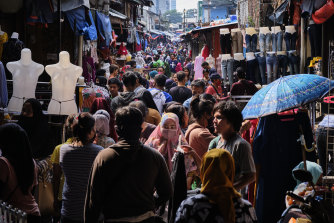 Indonesians crowd the Tanah Abang textile market to buy new clothing, a tradition for upcoming the Eid al Fitr holiday in Jakarta, Indonesia.