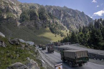 n Indian army convoy moves on the Srinagar- Ladakh highway at Gagangeer, northeast of Srinagar, Indian-controlled Kashmir. India has border disputes with China and Pakistan over sections of Kashmir.