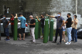 Family members of patients hospitalised with COVID-19 line up with empty oxygen tanks in an attempt to refill them, in Manaus, Amazonas state, Brazil.