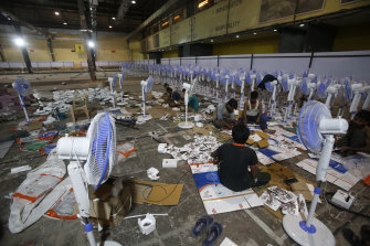 Laborers working to set up at COVID-19 field hospital in Mumbai.