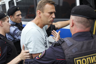 Russian police detain opposition politician Alexei Navalny during a march in Moscow in June.