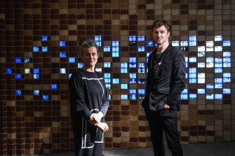 """Rose Hiscock, of the University of Melbourne, and Ryan Jefferies, from the Science Gallery, in front of the """"digital bricks"""" at the entrance to the new museum."""