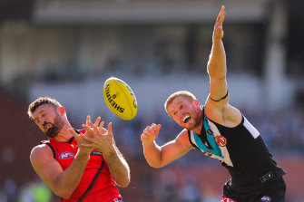 Cale Hooker of Essendon and Tom Clurey of Port Adelaide.