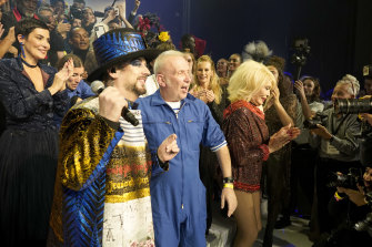 Jean-Paul Gaultier (centre) with Boy George at the designer's farewell show.