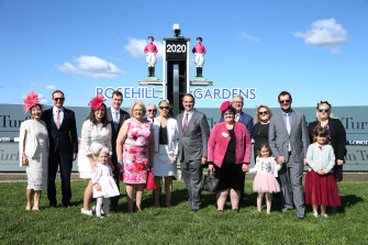 The Ingham family pose in front of the winning post at Rosehill on Saturday.