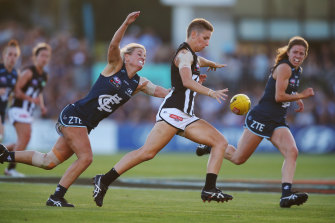Emma Grant in action for Collingwood in the first AFLW game.