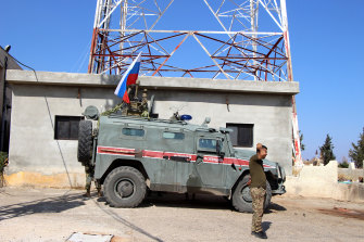 Russian armoured vehicles patrol the Syrian border in Kobani.