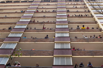 Residents of the densely populated Hillbrow neighbourhood of Johannesburg are confined to their apartments in an attempt to prevent the spread coronavirus.