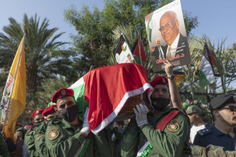 A Palestinian honour guard carries the body of Saeb Erekat into the cemetery during his funeral in the West Bank town of Jericho on Wednesday.