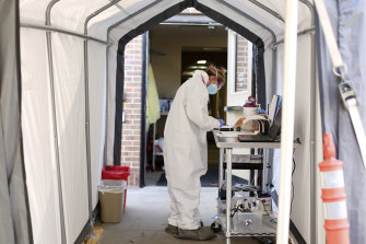 A medical worker at a coronavirus drive-through testing site in Casper, Wyoming, this month.