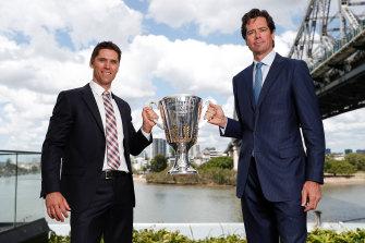 Simon Black and AFL boss Gillon McLachlan show off the premiership cup under Brisbane's Story Bridge.