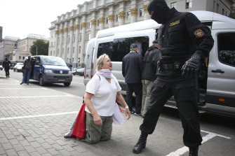 A woman argues with a policeman during a protest in Minsk, Belarus, on Tuesday.