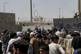 Hundreds of people gathered at an evacuation control point in the days before the bombing.