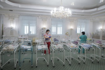 Nurses care for newborn babies at a hotel in Kiev, Ukraine. The dozens of babies born to surrogate mothers in the Ukrainian BioTexCom clinic wait for their foreign parents because they can't reach Ukraine due to border closures.