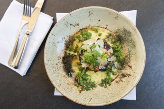The twice cooked goat cheese souffle, with snow pea cream, broad beans, peas, lemon and parmesan at Cafe Sydney.