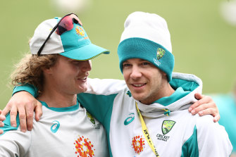 Tim Paine and Will Pucovski at training in Sydney earlier this year.