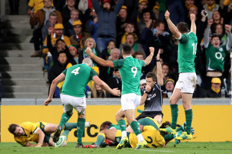 Irish players celebrate a try during the second Test.