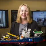 DHS national manager of cyber security Narelle Devine with a lego model used in the cyber war games last year.