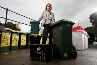 Danae Bosler, mayor of Yarra Council, with the bins from the council's trial of a new approach to household waste.