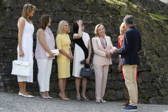Jenny Morrison, second from left, with other spouses: from left, US First Lady Melania Trump, Malgorzata Tusk, wife of European Council President Donald Tusk, Akie Abe, wife of Japan's Prime Minister Shinzo Abe, Chile's First Lady Cecilia Morel and Brigitte Macron, wife of French President Emmanuel Macron, are greeted by Espelette mayor Jean-Marie Iputcha in Espelette, near Biarritz.