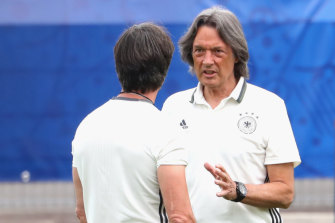 Hans-Wilhelm Mueller-Wohlfahrt (right) with German national soccer coach Joachim Low at Euro 2016.