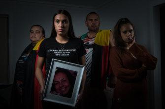 Tanya Day's children: (L-R) Belinda Stevens, Apryl Watson (with pic of Tanya), Warren Stevens and Kimberly Watson.