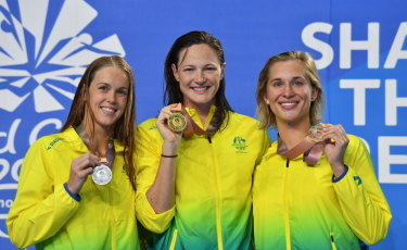 Whitewash: Australia claimed a 1-2-3 the women's 50m butterfly on Sunday night. Pictured are medallists Holly Barratt (silver), Cate Campbell (gold) and Madeline Groves (bronze).