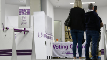 People casting their ballots at a central Sydney voting centre on the first day of prepoll voting for the federal election.