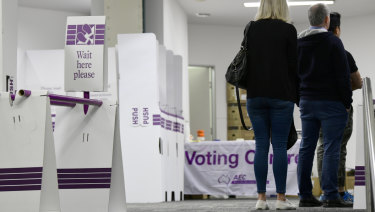 People casting their ballots at a Sydney voting centre on the first day of pre-poll at the 2019 federal election.