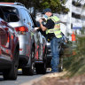 Police direct motorists at a Coolangatta border checkpoint last week.