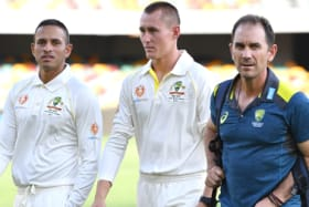 Two into three:  Usman Khawaja and Marnus Labuschagne, pictured with Justin Langer, both hope to bat at first drop.