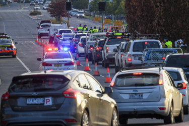 Quesues of commuters bank up at the NSW border as police stop drivers from Victoria to check their permits and licenses.