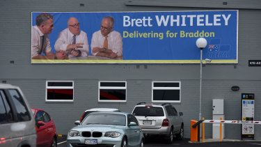 A billboard for Liberal candidate Brett Whiteley in Burnie, Tasmania, sees him flanked by the state's premier Will Hodgman and Prime Minister Malcolm Turnbull.
