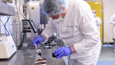 A chef from French chef Alain Ducasse's team prepares a low-temperature cooked salmon for the French astronaut Thomas Pesquet at the canning factory Henaff in Pouldreuzic, near Brest, western France.